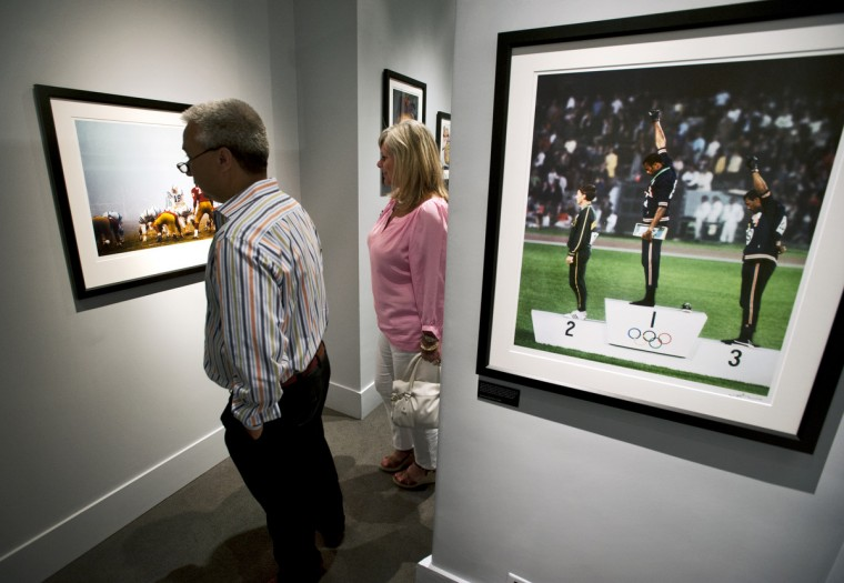 "Opening night of Neil Leifer's exhibit, which includes a famous image from the 1968 Olympics. Sports Legends Museum's ""Images We Remember -The World of Neil Leifer"" exhibit which will be on display until October 2014. (Christopher T. Assaf/Baltimore Sun)"
