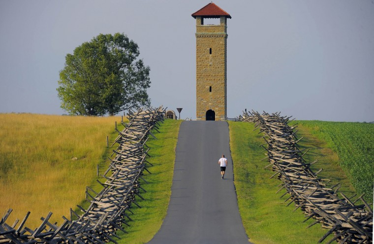 A jogger runs along the paved tour road leading to The War Observation Tower which over the Antietam National Battlefield. The historic battlefield, where thousands died in the bloody battle in 1862, has been carefully preserved. (Karl Merton Ferron/Baltimore Sun)