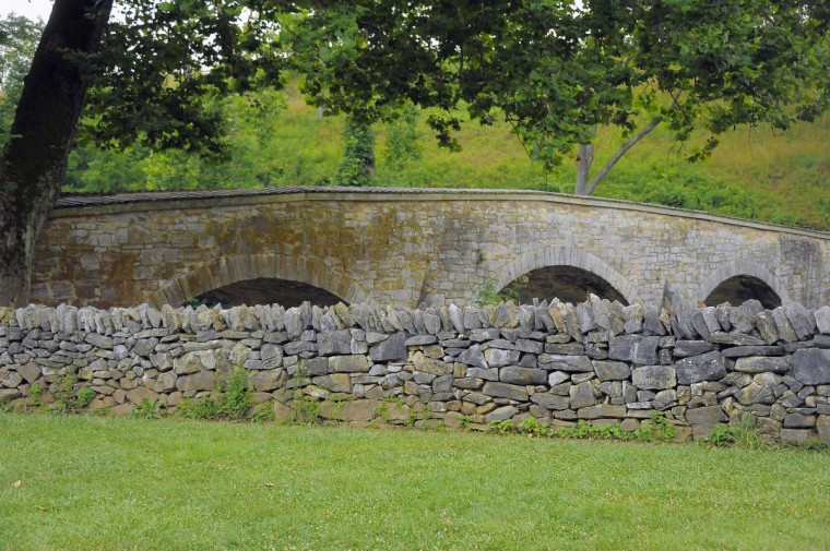 "A modern-day view of Burnside Bridge at Antietam National Battlefield. The angle, mimicking an 1862 stereo (or, 3-D) image called ""Soldier standing at graves of Federal soldiers, along stone fence, at Burnside Bridge, Antietam, Maryland. "" (Karl Merton Ferron/Baltimore Sun)"