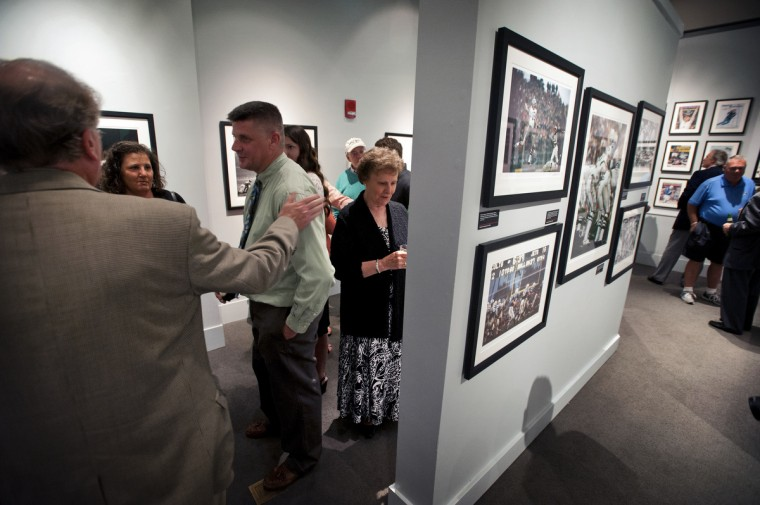 "The opening night for Sports Legends Museum's ""Images We Remember -The World of Neil Leifer"" exhibit which will be on display until October 2014. Included are iconic Leifer photographs such as Alan Ameche's game winning touchdown against the New York Giants in the 1958 NFL championship at Yankee Stadium and heavyweight champion Muhammad Ali standing over Sonny Liston after putting him down for a first-round knock out. (Christopher T. Assaf/Baltimore Sun)"