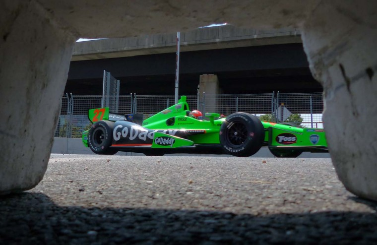 James Hichcliffe's car is framed in the drainage tunnel of a retaining wall as he hits turn 9 during the 2013 Grand Prix of Baltimore second day Saturday, Aug. 31, 2013. (Karl Merton Ferron/Baltimore Sun)
