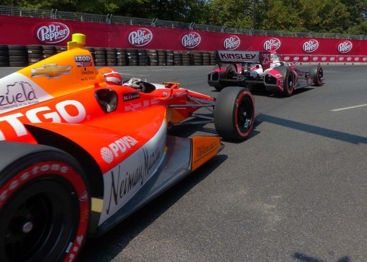 E.J. Viso follows Marco Andretti's no. 25 car out of turn 9 during the 2013 Grand Prix of Baltimore second day Saturday, Aug. 31, 2013. (Karl Merton Ferron/Baltimore Sun)