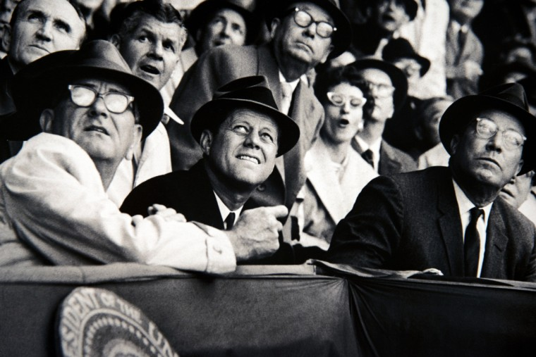 A detail from Neil Leifer photograph of President John F. Kennedy, center, on opening day 1961 in Washington, D.C. (Christopher T. Assaf/Baltimore Sun)