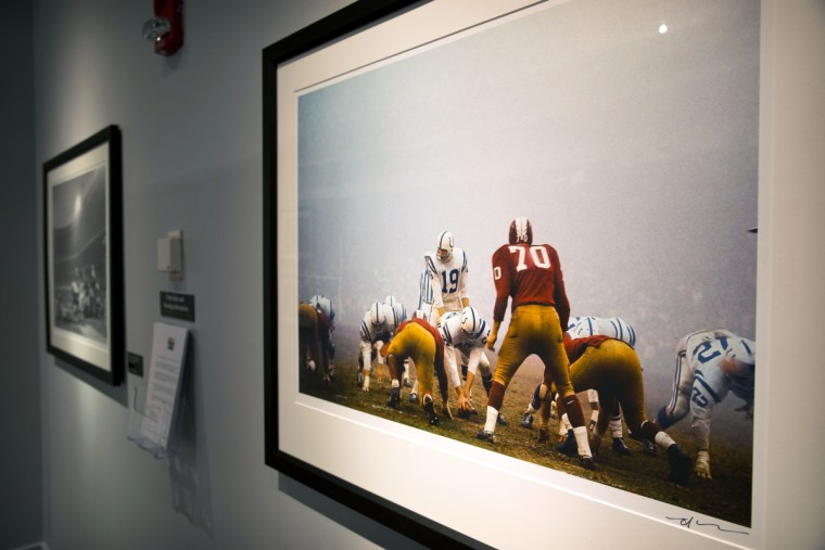"Johnny Unitas, Baltimore Colts quarterback, playing against the Washington Redskins. Sports Legends Museum's ""Images We Remember -The World of Neil Leifer"" exhibit which will be on display until October 2014. (Christopher T. Assaf/Baltimore Sun)"