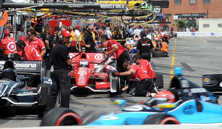 IndyCars are worked on in pit row at the start of qualifying race on Saturday, Aug. 31, 2013. (Jerry Jackson/Baltimore Sun)