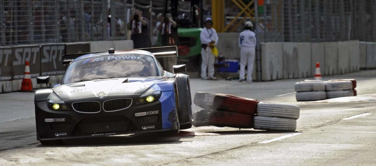 The Auberlen/Martin BMW Z4 GTE car hits the tire barrier at one of the chicane during qualifying run for the ALMS GT class at the Grand Prix of Baltimore Friday, Aug. 30, 2013. (Kenneth K. Lam/Baltimore Sun)
