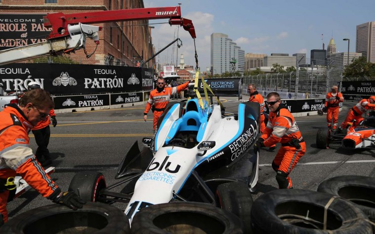 Race track officials remove Graham Rahal's disabled car from the track at the Grand Prix of Baltimore Saturday, Aug. 31, 2013. (Kaitlin Newman/Baltimore Sun)
