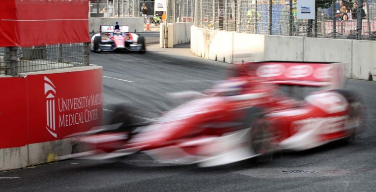 Scott Dixon makes the turn onto Pratt Street during the Saturday IndyCar practice session, Aug. 31, 2013.(Kaitlin Newman/Baltimore Sun)