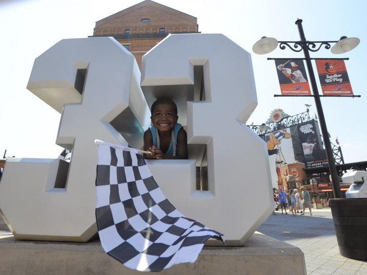 Dorian Jordan, 3, plays on Eddie Murray's #33 at OPACY during the Grand Prix of Baltimore. (Lloyd Fox/Baltimore Sun)