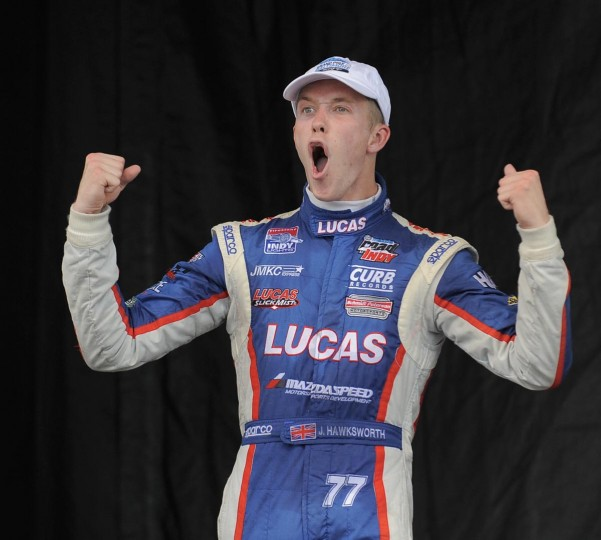 Jack Hawksworth, winner of Indy Lights, celebrates as he is introduced as the winner on the winner's podium at the Grand Prix of Baltimore on Sept. 1, 2013. (Lloyd Fox/Baltimore Sun)