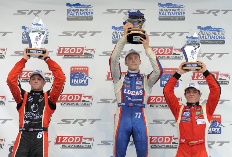 Indy Lights drivers on the Winner's Podium - (L to R) Sage Karam (2nd), Jack Hawksworth (1st), and Gabby Chaves (3rd) at the Grand Prix of Baltimore on Sept. 1, 2013. (Lloyd Fox/Baltimore Sun)