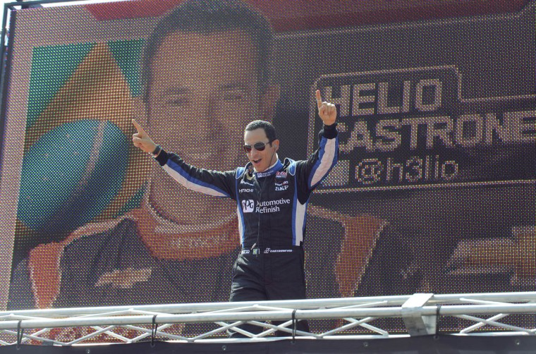 Helio Castroneves is introduced at the Grand Prix of Baltimore. (Lloyd Fox/Baltimore Sun)