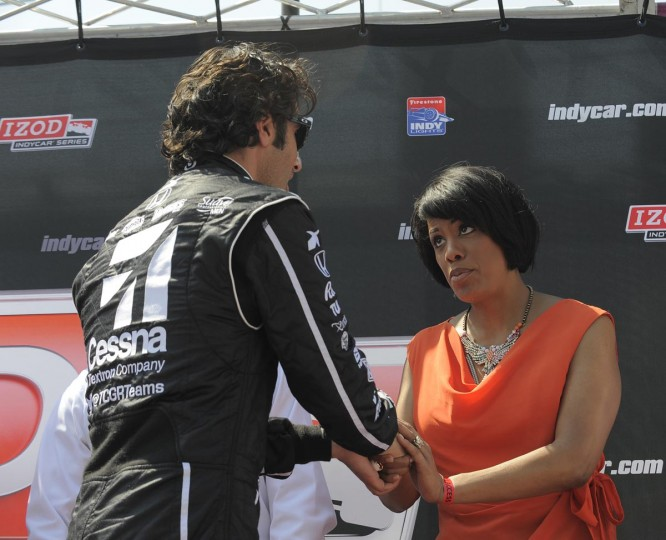 Dario Franchitti speaks to Baltimore Mayor Stephanie Rawlings-Blake after being introduced at the Baltimore Grand Prix on Sept. 1, 2013. (Lloyd Fox/Baltimore Sun)