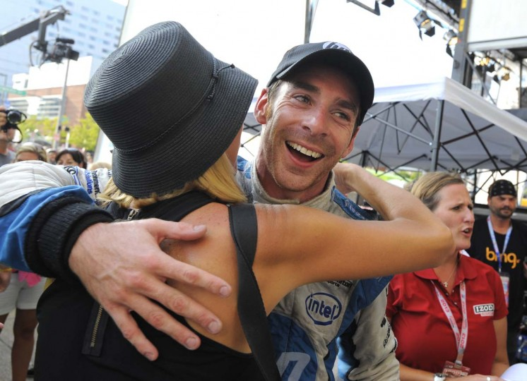 IndyCar winner Simon Pagenaud celebrates his victory in the winner's circle. Grand Prix of Baltimore on Sept. 1, 2013. (Lloyd Fox/Baltimore Sun)