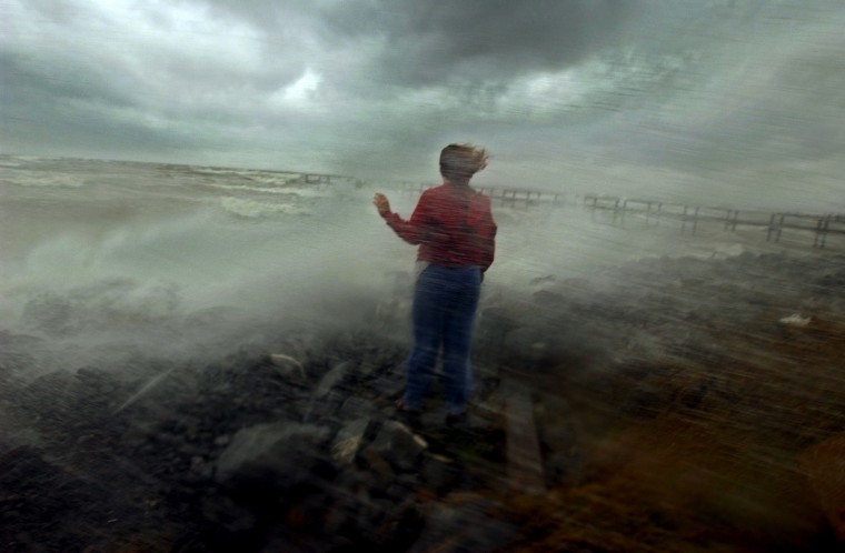 Helga Hertlein of Great Mills watches the waves pound the shoreline around her at the end of Scotland Beach Road overlooking the Chesapeake Bay as Hurricane Isabel slams into the eastern seaboard and into the mid-Atlantic states September 18, 2003. (Karl Merton Ferron/Baltimore Sun)