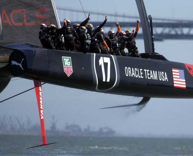 Oracle Team USA sailors celebrate their victory over Emirates Team New Zealand in race 17 of the 34th America's Cup. (Ross Cameron / Bay Area News Group / MCT)