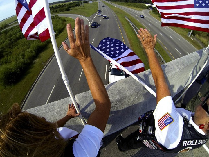 Flags are waved on the bridge at Harrelson Boulevard/George Bishop Parkway over U.S. 17 Bypass in Myrtle Beach by members of Rolling Thunder and the Myrtle Beach Lions Club, Wednesday, September 11, 2013, to mark the 12th anniversary of the Sept. 11 terrorist attacks. (Charles Slate/Myrtle Beach Sun-News/MCT)