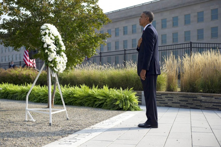 President Barack Obama participates in a wreath laying ceremony at the Pentagon in remembrance of the 12th anniversary of the 9/11 terrorist attacks, in Arlington, Virginia, Wednesday, September 11, 2013. (Kevin Dietsch/UPI/Pool/Abaca Press/MCT)