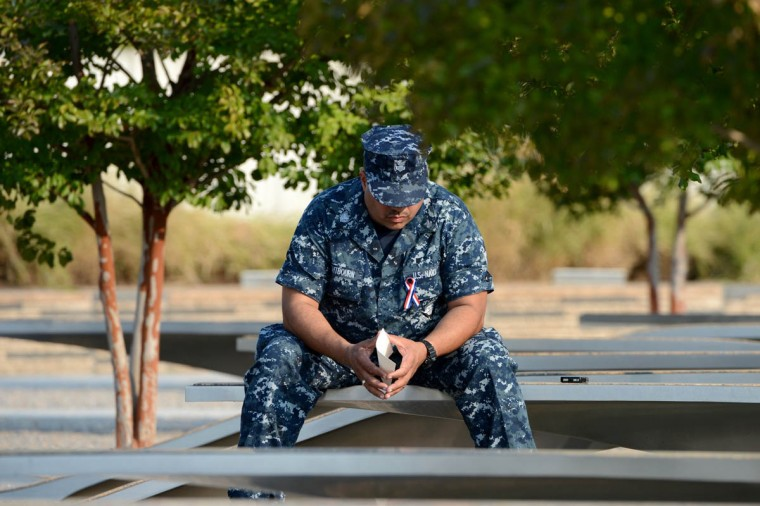 A man reflects on the benches of the Pentagon Memorial at the Pentagon in Arlington, Virginia, Wednesday, September 11, 2013. There are 184 benches in the Pentagon Memorial representing the 184 people who died at the Pentagon on September 11, 2001. (Pat Benic/Abaca Press/MCT)