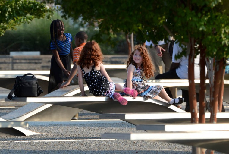 Children rest on the benches of the Pentagon Memorial at the Pentagon in Arlington, Virginia, Wednesday, September 11, 2013. There are 184 benches in the Pentagon Memorial representing the 184 people who died at the Pentagon on September 11, 2001. (Pat Benic/Abaca Press/MCT)