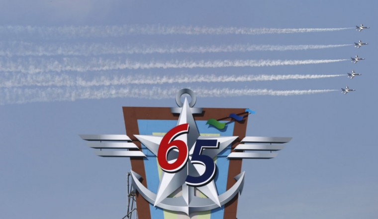 "The South Korean air force aerobatic team ""Black Eagles"" flies over a board symbolizing the upcoming 65th anniversary of the Armed Forces Day during a rehearsal at a military airport in Seongnam, south of Seoul. (REUTERS/Kim Hong-Ji)"