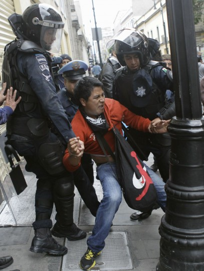 A protester is arrested by the riot police during clashes as striking members of the teachers' union CNTE are evicted from Zocalo Square in downtown Mexico City. (Henry Romero / Reuters)