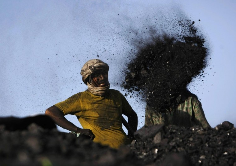 Laborers work at a coal dump site outside Kabul September 3, 2013. (Mohammad Ismail/Reuters)