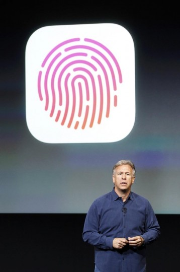 Phil Schiller, senior vice president of worldwide marketing for Apple Inc, talks about the new iPhone 5S Touch ID fingerprint recognition feature at Apple Inc's media event in Cupertino, California September 10, 2013. (Stephen Lam/Reuters)