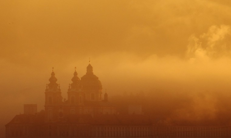 Melk Abbey is pictured through mist in the morning sun in Melk, about 80 km (50 miles) west of Vienna. (Heinz-Peter Bader/Reuters)