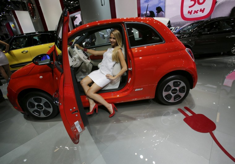 A model poses inside a Fiat 500 E car during a media preview day at the Frankfurt Motor Show (IAA) September 10, 2013. The world's biggest auto show is open to the public September 14 -22. (Wolfgang Rattay/Reuters photo)