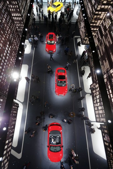The stand of German car manufacturer Audi is reflected in the ceiling during a media preview day at the Frankfurt Motor Show (IAA) September 11, 2013. The world's biggest auto show is open to the public September 14 -22. (Kai Pfaffenbach/Reuters photo)