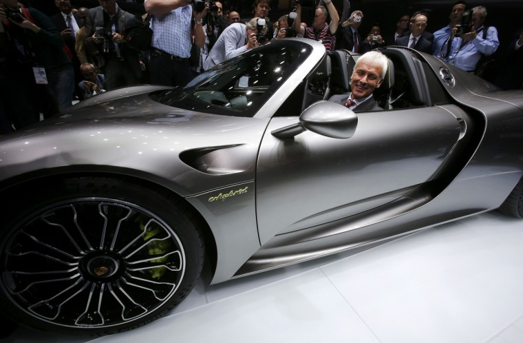 Porsche CEO, Matthias Mueller sits inside the new Porsche 918 Spyder hybrid car during a media preview day at the Frankfurt Motor Show (IAA) September 10, 2013. The world's biggest auto show will open to the public September 14-22. (Wolfgang Rattay/Reuters photo)