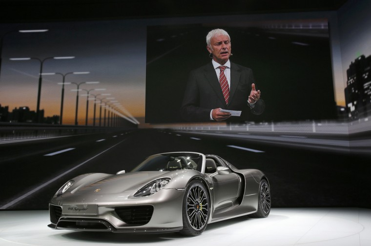Porsche CEO, Matthias Mueller is seen on a screen as he presents the new Porsche 918 Spyder hybrid car during a media preview day at the Frankfurt Motor Show (IAA) September 10, 2013. The world's biggest auto show will open to the public September 14-22. (Wolfgang Rattay/Reuters photo)