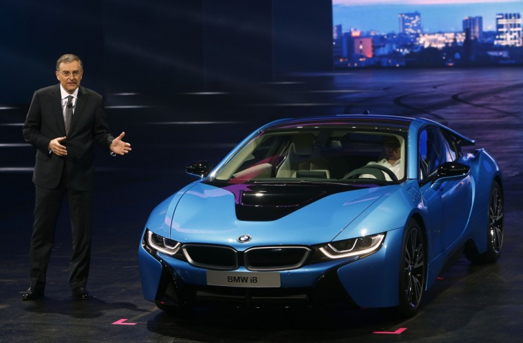 BMW CEO Norbert Reithofer presents the BMW i8 hybrid supercar during a media preview day at the Frankfurt Motor Show (IAA) September 10, 2013. The world's biggest auto show is open to the public September 14 -22. (Ralph Orlowski/Reuters photo)