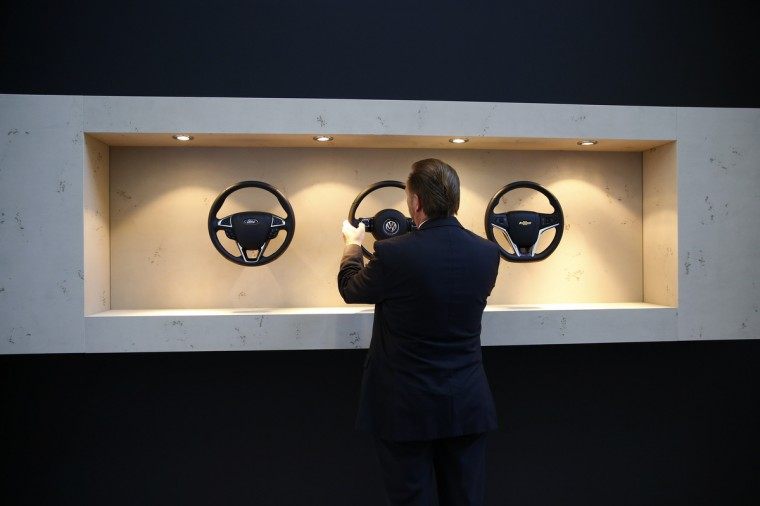 A visitor compares steering wheels at the Takata exhibition stand during a media preview day at the Frankfurt Motor Show (IAA) September 10, 2013. The world's biggest auto show is open to the public September 14 -22. (Kai Pfaffenbach/Reuters photo)