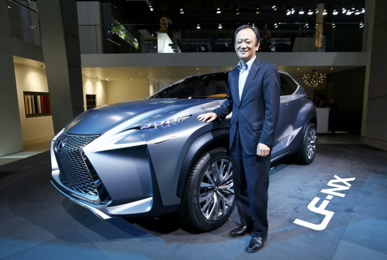 Tokuo Fukuichi, executive vice president of Lexus, poses next to a Lexus LF-NX mid-size crossover concept during a media preview day at the Frankfurt Motor Show (IAA). (Ralph Orlowski/Reuters photo)