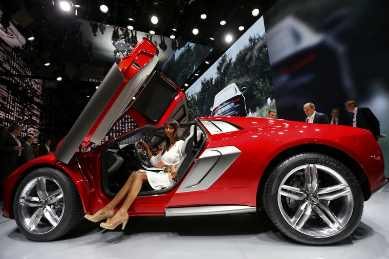 A model poses in an Audi Nanuk Quattro concept car during a media preview day at the Frankfurt Motor Show (IAA) September 10, 2013. (Kai Pfaffenbach/Reuters photo)