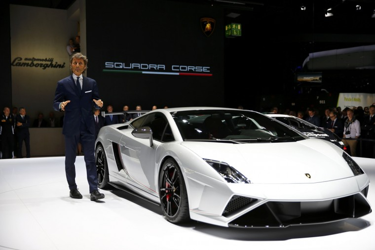 Stephan Winkelmann, President and CEO of Lamborghini speaks next to a Lamborghini Gallardo LP570-4 Squadra Corse during a media preview day at the Frankfurt Motor Show (IAA). (Kai Pfaffenbach/Reuters photo)