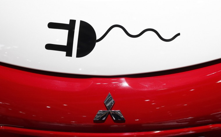 A pictogram of an electric connector is pictured at a Mitsubishi MiEV during a media preview day at the Frankfurt Motor Show (IAA) September 11, 2013. The world's biggest auto show is open to the public September 14 -22. (Ralph Orowski/Reuters photo)