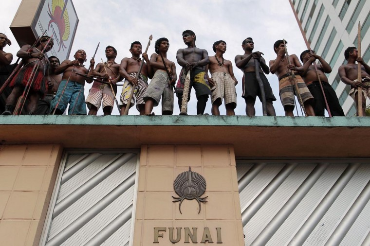 Members of different Amazonian tribes occupy the headquarters of Brazil's Indian affairs bureau FUNAI as they protest a court decision to evict them from a nearby plot of land they have been occupying for several weeks, in Manaus September 19, 2013. (Bruno Kelly/Reuters)