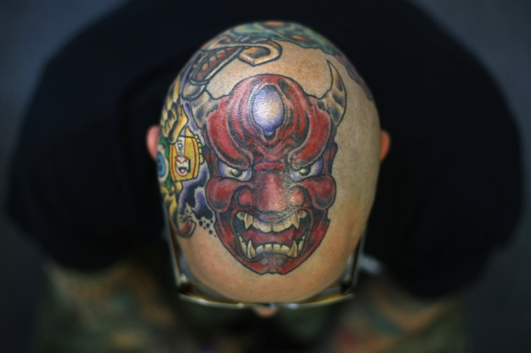 Matt Grosso displays a tattoo on his head during the ninth London International Tattoo Convention in London September 27, 2013. (Stefan Wermuth/Reuters photo)