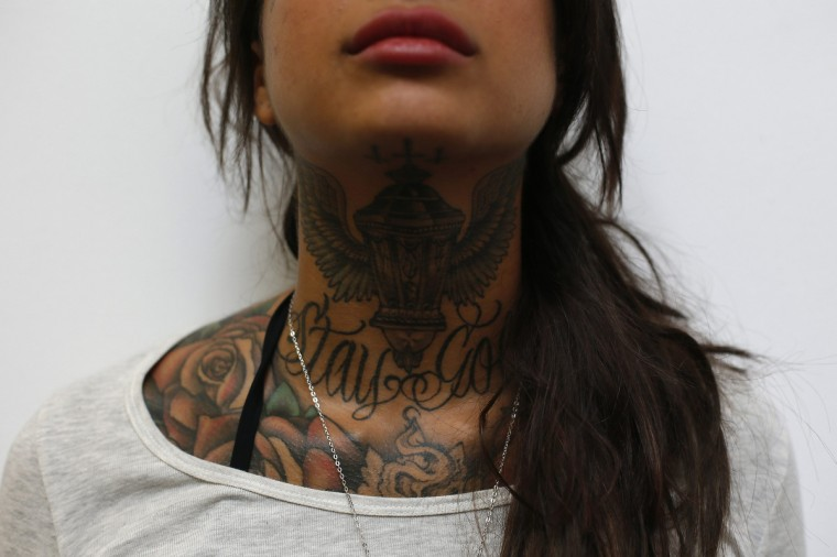 Cleo displays tattoos on her neck during the ninth London Tattoo Convention in London September 27, 2013. (Stefan Wermuth/Reuters photo)