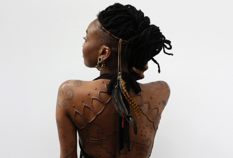 Model Moniasse displays her tattoos during the ninth London Tattoo Convention in London September 27, 2013. (Stefan Wermuth/Reuters photo)