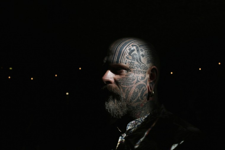 Tattoo artist Matt Black displays tattoos on his head during the ninth London International Tattoo Convention in London September 27, 2013. (Stefan Wermuth/Reuters photo)