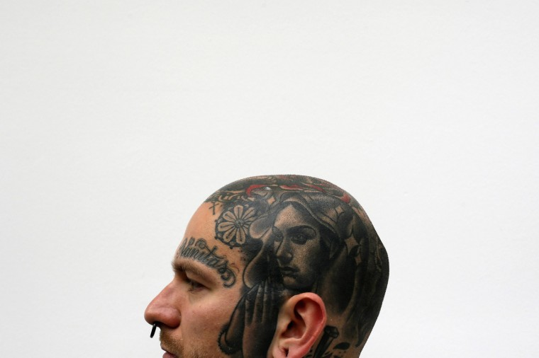 Jakub displays a tattoo on his head during the ninth London International Tattoo Convention in London September 27, 2013. (Stefan Wermuth/Reuters photo)
