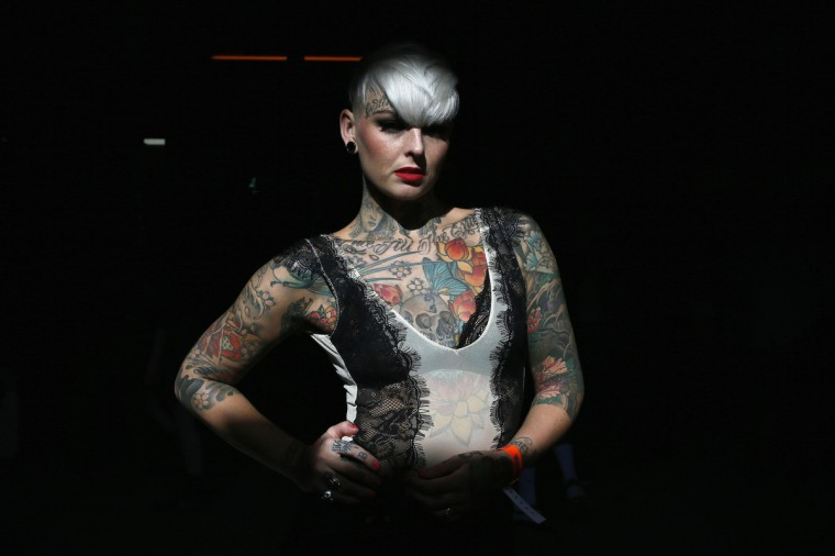 Jade Allison displays her tattoos during the ninth London Tattoo Convention in London September 27, 2013. (Stefan Wermuth/Reuters photo)