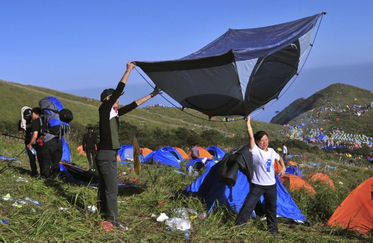 Campers pack up a tent during the 2013 International I Camping Festival in Mount Wugongshan of Pingxiang, Jiangxi province. The event which opened on September 14 attracted more than 15,000 campers from all over the world, according to Xinhua News Agency. (Reuters)