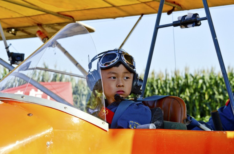 He Yide sits in a glider before flying a plane in Guan county, Hebei province. He, 5, piloted a plane, accompanied by his coach last Saturday. The flight from Guan county to Beijing Wildlife Park at 150 m (492 feet) high took around 35 minutes and landed successfully. (Reuters)