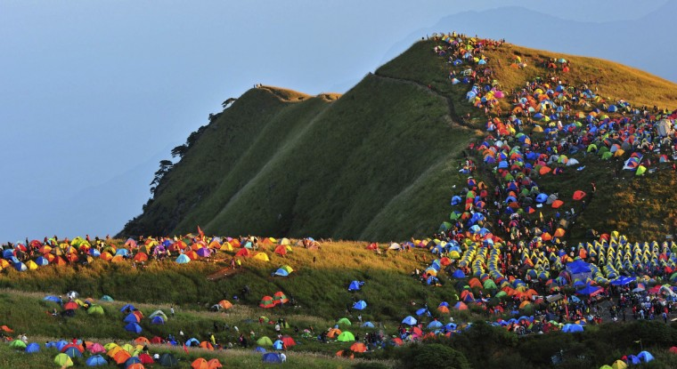 Numerous tents are seen during the 2013 International I Camping Festival in Mount Wugongshan of Pingxiang, Jiangxi province. The event which opened on September 14 attracted more than 15,000 campers from all over the world, according to Xinhua News Agency. (Reuters)