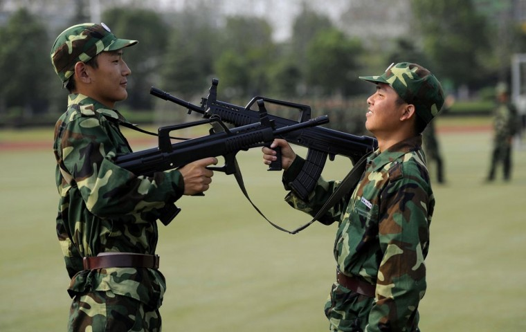 University freshmen point at each other with toy guns during a break in their military training at a campus in Hefei, Anhui province, September 3, 2013. (Stringer/Reuters)
